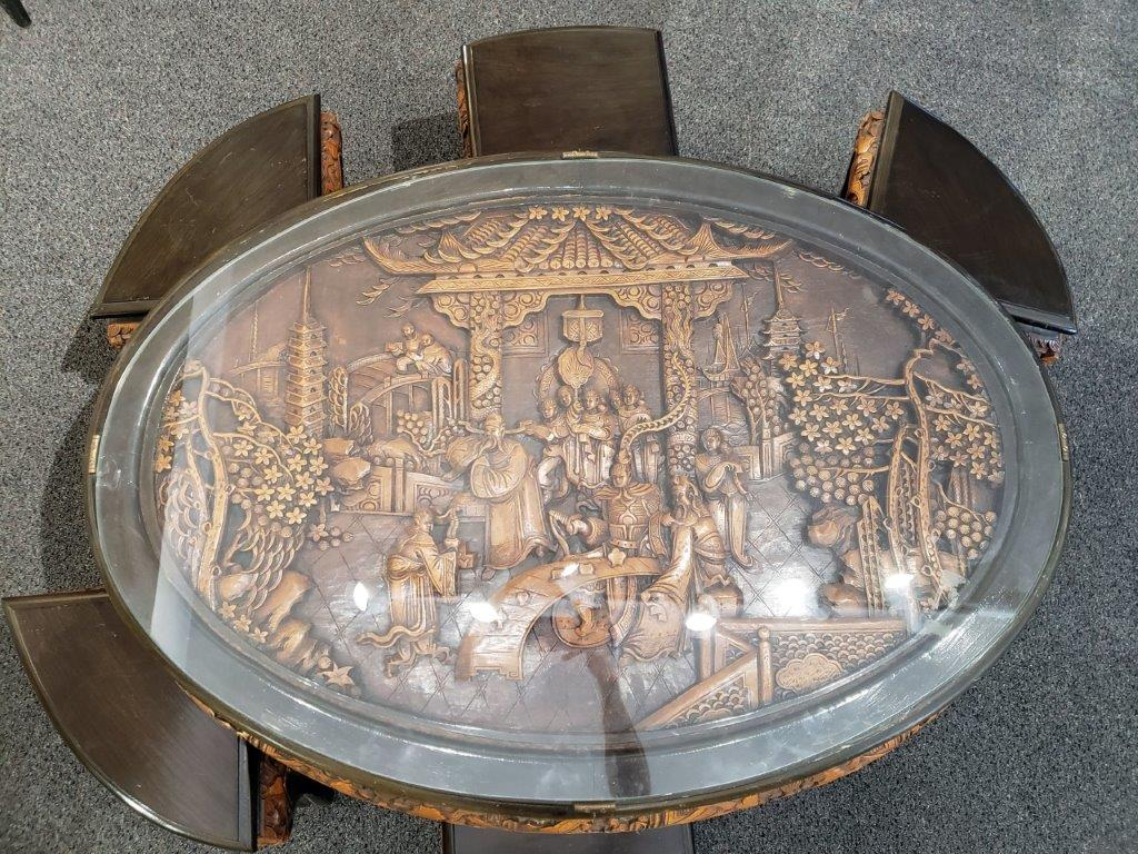 Chinese Oval Coffee Table with Hand-Carved King in Palace Scene and Six Stools